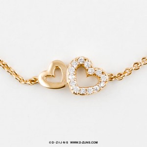 Armband gold plated met dubbele hartjes strass